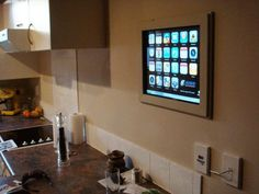 Enjoy cooking recipes from the web, but don't want to waste valuable counter space on a monitor and keyboard? Well, then you might be interested in The iPhone Inspired DIY Kitchen Touch Screen Project by Ryan of JUDD Studio Engineering.