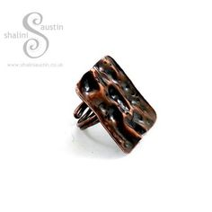 One off Copper Ring made fromhand forged from sheet metal using air chasing and texturing coppersmithing techniques.Each copper ring isindividually hammered, textured and forged by hand and will have a one of a kind pattern.This chunky statement ring has been given an antique patina finish for a timeless look.The
