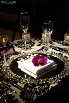 Love the black and white damask tablecloth and rhinestone chargers.