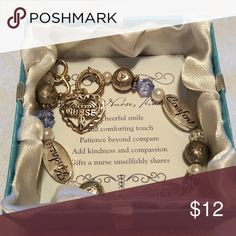 Charm Bracelet The perfect gift for that one special nurse you might know. It's a beautiful silver bracelet with stunning charms. It is brand new and comes in a beautiful satin lined gift box. Jewelry Bracelets