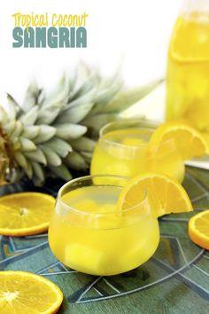 Tropical Coconut Sangria: Pineapple, Mango, Orange Vodka, White Wine, Coconut Water.