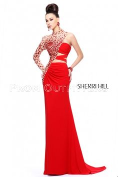 urn heads in this unbelievable evening dress by Sherri Hill 21002. The high neckline bodice sparkles with large, jeweled embellishments and has a single long, illusion sleeve for a fashionable asymmetrical look. Available in colors: Fushia, Purpe and Red