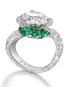 De Grisogono ring in white gold set with round cut diamond surrounded by 58 emeralds ( and 224 white diamonds ( Trendy Fashion Jewelry, Fashion Jewelry Necklaces, High Jewelry, Women's Fashion, Luxury Jewelry, Couture Fashion, Fashion Outfits, Emerald Jewelry, Diamond Jewelry