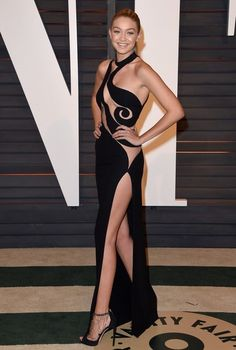 Gigi Hadid Cutout Dress - Gigi Hadid left little to the imagination in a sizzling-hot Atelier Versace cutout dress during the Vanity Fair Oscar party.
