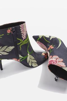 Say hello to ss17's statement shoe. The MIMOSA floral ankle boots come in a pretty floral print with a practical mid heel, perfect for wearing from day to night.