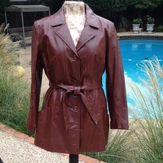 Vintage leather jacket Cool rust /brown vintage leather jacket. Belted to highlight your waist and a zipper lining in matching color for warmth and coziness. Says size 16 but I think fits more like a medium would. Vintage Jackets & Coats