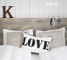 different, love the wood head board and love the l-o-v-e pillow :)
