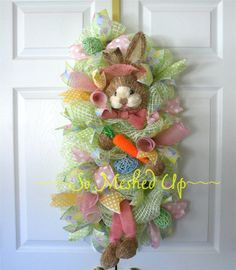 Check out this item in my Etsy shop https://www.etsy.com/listing/221852465/pastel-deco-mesh-easter-swag-in-pastel