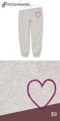 Children's Place Cozy Sweatpants Lounging never looked more sparkly!! * Body made of 55% cotton/45% polyester fleece; brushed for softness  * Rib-knit waist and leg cuffs made of 57% cotton/38% polyester/5% spandex  * Glitter graphic at front hip  * Non-functional twill bow at waist  * Pre-washed for an extra-gentle feel and to reduce shrinkage  * Note: Neon Berry is a neon style  * Imported  Big Fashion, Little Prices Children's Place Bottoms Sweatpants & Joggers