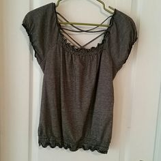 Black and white top Short sleeve, criss cross back makes so feminine and sweet! Tops