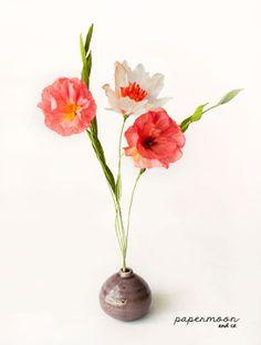 Centro flores Rojas Delic papel