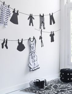 with white, clothes line wall display. Future laundry room decor?