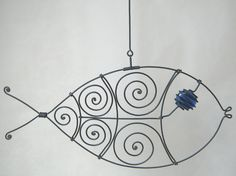 Wire art fish in blue. - like the swirls Wire Crafts, Metal Crafts, Fish Sculpture, Sculptures, Art Fil, Wire Ornaments, Scrap Metal Art, Wire Weaving, Fish Art