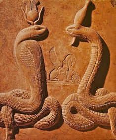 From the Cairo Museum, a stela with Isis (left) and Osiris (right) in snake-form, with the griffin of the goddess Nemesis between them.