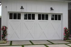 Clopay Coachman Collection insulated steel and composite carriage house garage door. Cross buck design with REc13 windows in white. www.clopaydoor.com. Photo Credit: Agi Dyer