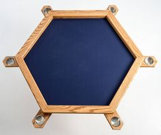 A table just for playing board games. It even has a topper that sits over an in-progress game so it can be used as a dining table.