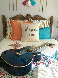 Adventure Awaits! Create a boho chic teen girls bedroom with arrow and feather bedding, wood accents and other bohemian decor.