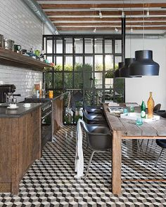 black and white floor, farm table, raw wood cabinets, wall of windows, open shelving...
