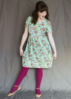 Love the dress and the colors, especially paired with the bright fuchsia tights and neutral flats. #modcloth #stylegallery