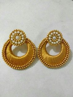 Handmade Simple and Well-designed golden Silk thread, white beads and artificial pearl Earring. Pair with ethnic Indian wear like sarees, salwar suits and lehengas. #craftsofindia #indianhandicrafts #madeinindia #craftsbazaar #artsandcrafts #handmade
