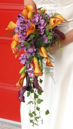 Cascading Bouquet Featuring Orange and Purple Calla Lilies, Purple Alstromeria and Trailng Ivy.   Like the shape, like the orange calla lillies.