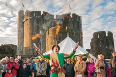 Fire juggler, Medieval Christmas Fayre Caerphilly Castle, © Crown copyright (2013) Visit Wales Visit Wales, Cymru, Caerphilly, Festivals, Medieval, Castle, Fire, Crown, Painting