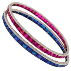 VAN CLEEF & ARPELS Art Deco Pair of Ruby Sapphire & Platinum Bangle Bracelets, A pair of outstanding Art Deco bangles created by Van Cleef & Arpels in the 1920's - elegant, understated, chic! Made of platinum.