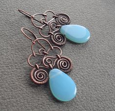 very pretty.  Previous pinner said copper & turquoise. I think it looks more like chalcedony.