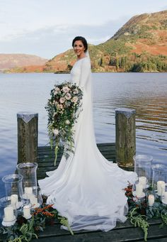A stunning bride, carrying a stunning bouquet in a stunning location. This huge cascading bouquet was filled with nude roses, soft peaches and fabulous seasonal foliages. Captured at the Inn On The Lake Glenridding