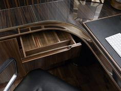 Macassar Ebony draws in a modern study designed by the LINLEY Fitted Cabinetry team. |Interior Design |Luxury Materials| Office