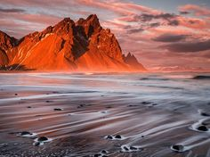 The sun sets over Vestrahorn at Stokksnes in southeastern Iceland in this National Geographic Photo of the Day from the Traveler Photo Contest.