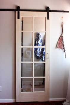 It has been my plan to add a sliding door between the bedroom and small master bathroom since day one. External Sliding Doors, Sliding Door Panels, Partition Door, Exterior Door Colors, Exterior Front Doors, Orange Front Doors, Diy Barn Door Hardware, Glass Front Door, Diy Door