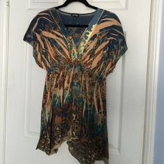 Beautiful multi colored tunic top This pretty tunic top has lots of blues, aquas, oranges and tans. There is a blue studded detail at the neckline (shown in pic 2). EUC. worn a couple times but looks brand new. Apt. 9 Tops Tunics