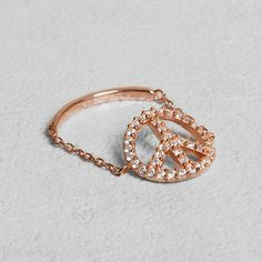 Petit Sesame | Rose gold-plated peace ring | Designed by Petit sesame | $16.00 | Peace ring on rose gold plated 925 sterling silver flexible chain