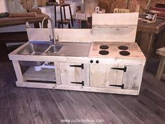 And on the base it has got pallet wooden cabinets that are a must have for a kitchen because you have to keep a number of accessories whether it be the utensils, crockery, or some other kitchen related stuff. So this sensational kids kitchen is fully equipped with all basic needs.