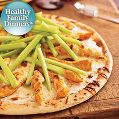 Blue cheese dressing makes a tangy sauce in this chicken, celery and mozzarella cheese pizza recipe. Hot sauce is drizzled prior to baking and then passed on the side for those who like spicier food.