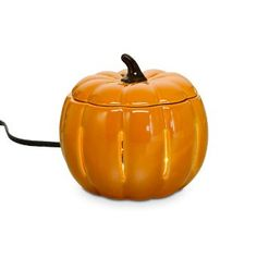 "Welcomes autumn's arrival with a cheerful sculpted shape and housewarming scent. Ceramic electric warmer radiates a soft glow while releasing the fragrance of Scent Plus® Melts or scented oil, sold separately. Includes lid; remove for stronger fragrance throw. Black cord. 4¾""h, 3½""dia."