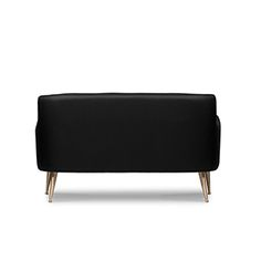 Dandridge is an organically shaped sofa that makes a statement through its accented and slighty sloping arms. It features tapered legs in polished brass, one of the best calling cards of the mid-century modern furniture.