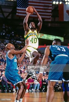 Shawn Kemp of the Seattle Supersonics shoots against the Charlotte Hornets  circa 1995 at Key Arena 406dadf54