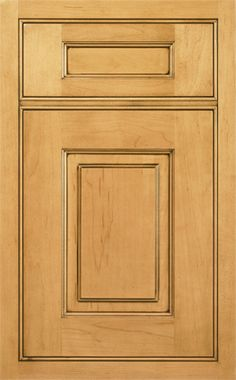 Coronado Raised door style by #WoodMode, shown in Sandstone II finish with Pewter glaze on maple.