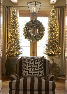 two tall thin trees flanking window make a wonderful statement
