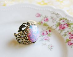 Vintage Pink Glass Fire Opal Ring- Antiqued Brass Opal Ring. $18.00, via Etsy.
