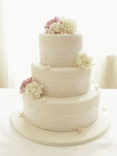 Ivory Roses And Lace Three Tier Wedding Cake