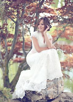 I love this pic.....you could do it at the park in wetumpka!!!! Simple Lace - Modest Wedding Gown