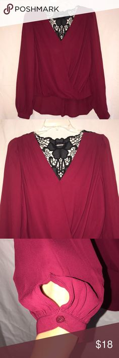 Going out top Never Worn, High low Long Sleeve shirt perfect for a night out. The wrists have button closures and there is a black lace design across the Back! The color is a Darker Red 100% Polyester VENUS Tops Blouses