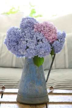 Love the use of the old jug with these hydrangeas.  Great pop of pink too.