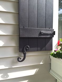Edie, from Ohio, was very kind to send us her pictures of the new shutters she g. Shutters Brick House, Window Shutters Exterior, Outdoor Shutters, Cedar Shutters, Farmhouse Shutters, Black Shutters, House Paint Exterior, Exterior House Colors, Exterior Design