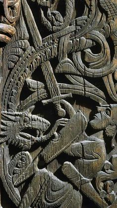 12th century norse wood panel from a church in setesdal norway. from the edda: sigurd slays the dragon fafnir