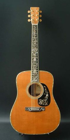 Martin D-45 Deluxe Tree of Life (1993) : Limited run of 50. Bearclaw spruce top, Brazilian rosewood back & sides.