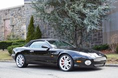 This 2003 Aston Martin DB7 Volante is an extremely rare and desirable stick-shift example. Black with cream interior. Don't miss this highly sought after modern-classic for just $49,500  #gullwingmotorcars #classiccars #buy&sellclassiccars #VintageCarBuyer #ClassicCar  #antiqueCarBuyer #2003AstonMartinDB7Vantage #AstonMartinDB7Vantage #DB7Vantage #AstonMartin